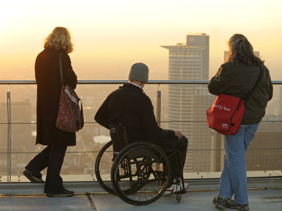 A wheelchair user and his escorts on the Main Tower's observation platform