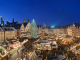 Panorama view of the illuminated Christmas market at night