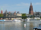 View of Frankfurt Cathedral and bridge Eiserne Steg from the Main embankment