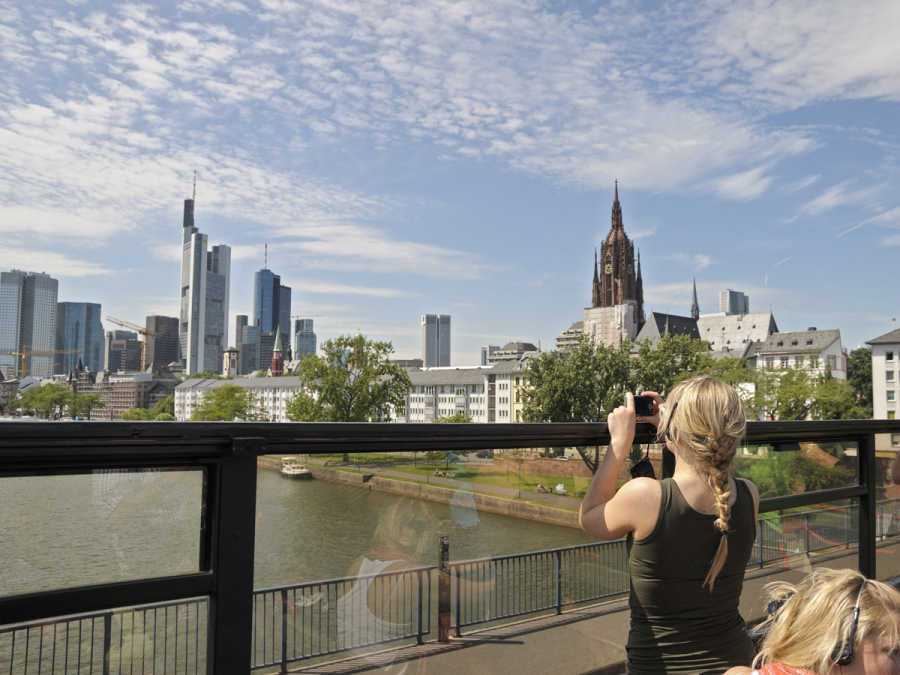 View of Frankfurt's skyline from the top deck of a hop on-hop off bus